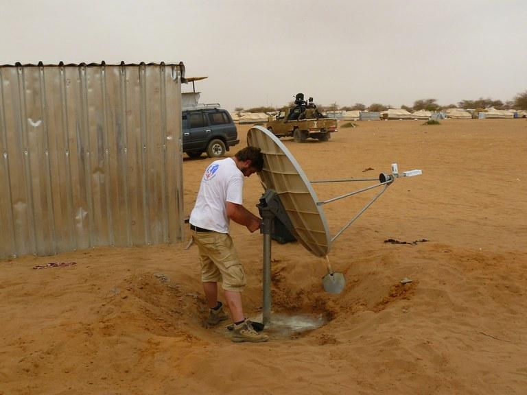 TSF staff installing a VSAT in Niger